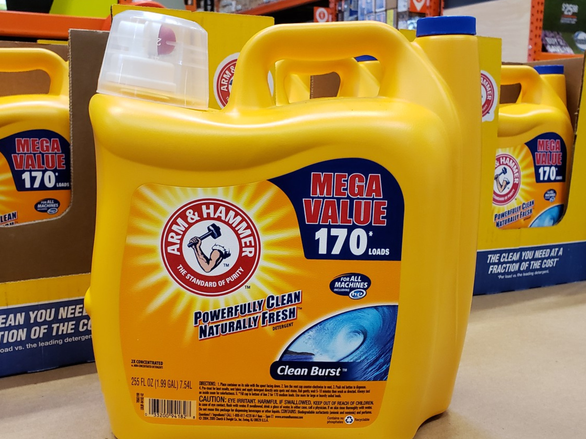huge yellow bottle of detergent sitting on counter in store