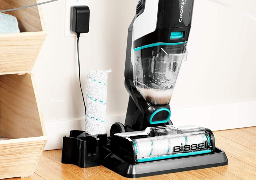 BISSELL Crosswave Max plugged into the wall charging and self cleaning
