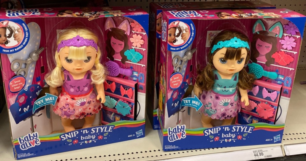 two Baby Alive Snip n Style on shelf at Target