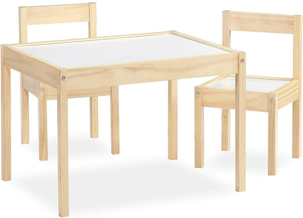 Light colored wooden table with matching chairs