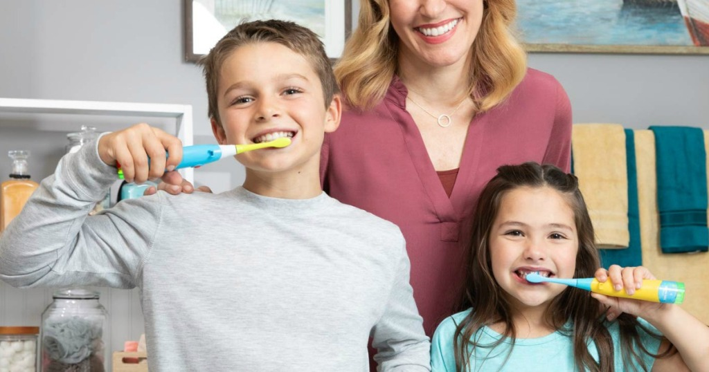 Kids brushing with Baby Shark Toothbrushes