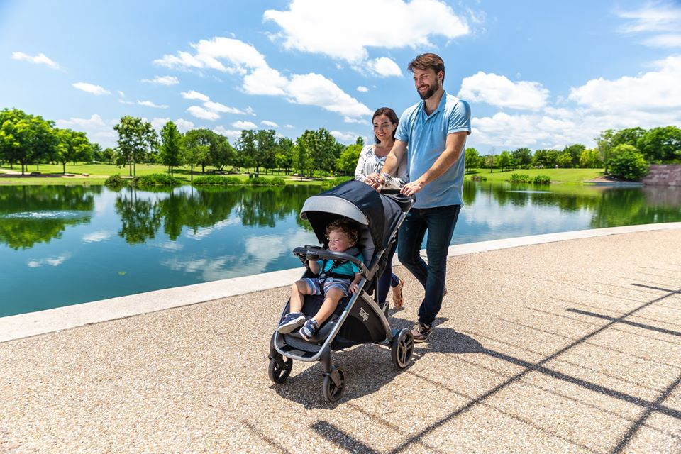 couple pushing a stroller