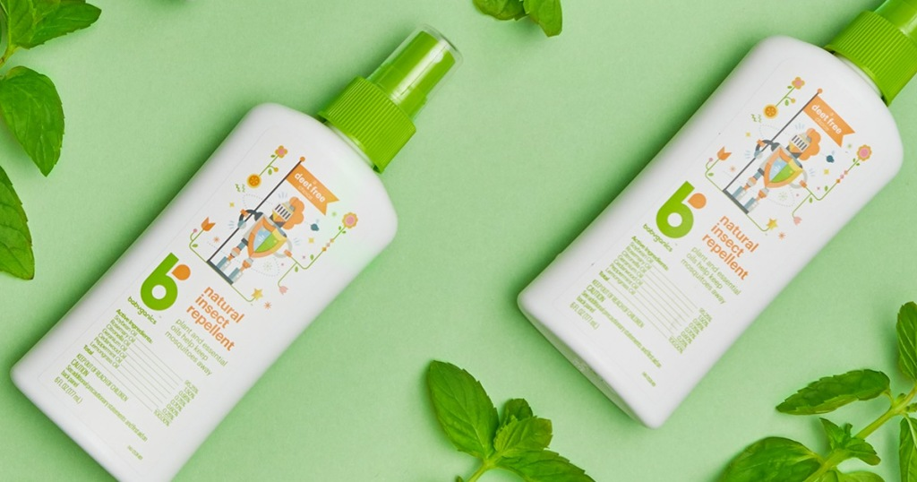 bottles of babyganics bug spray on green background with mint leaves