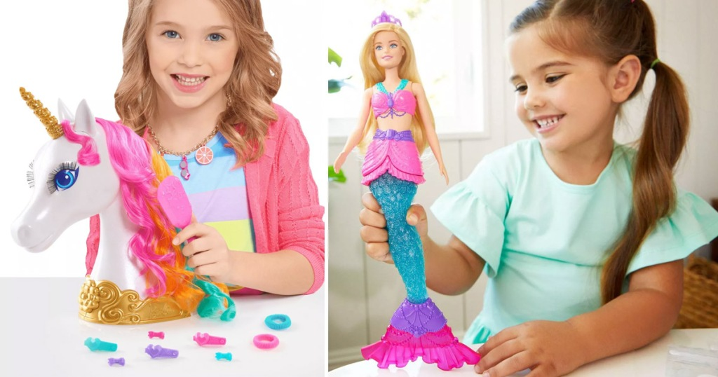 girl playing with barbie unicorn styling head and another girl playing with a mermaid barbie