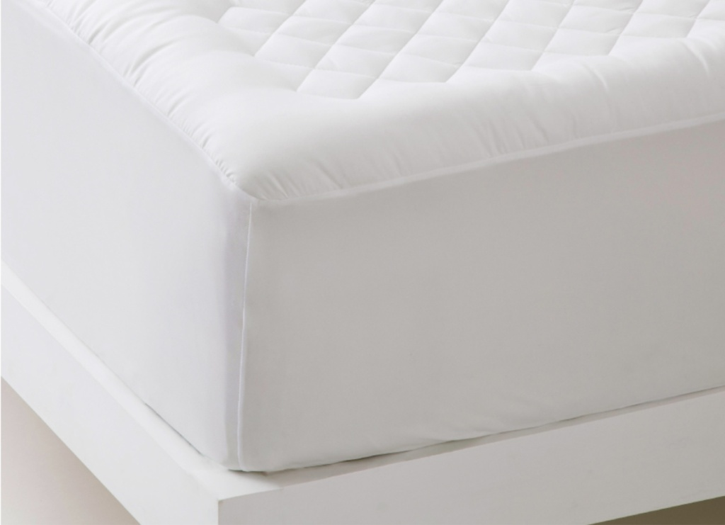 Bedsure Quilted Mattress Protector on bed close up
