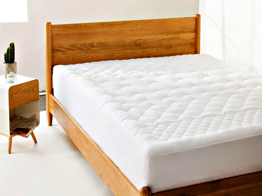 Bedsure Quilted Mattress Protector on bed in bedroom