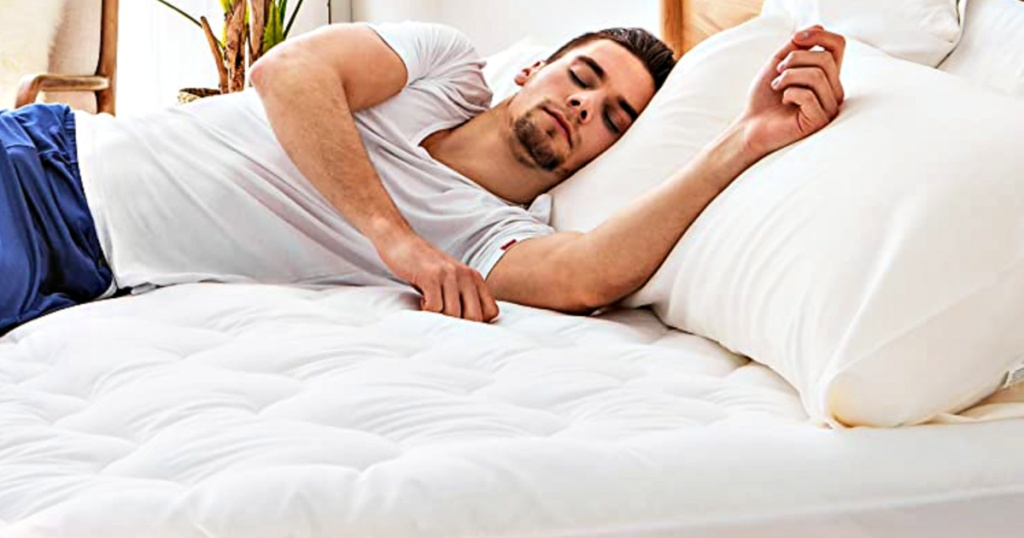 Bedsure Quilted Mattress Protector on bed with man asleep