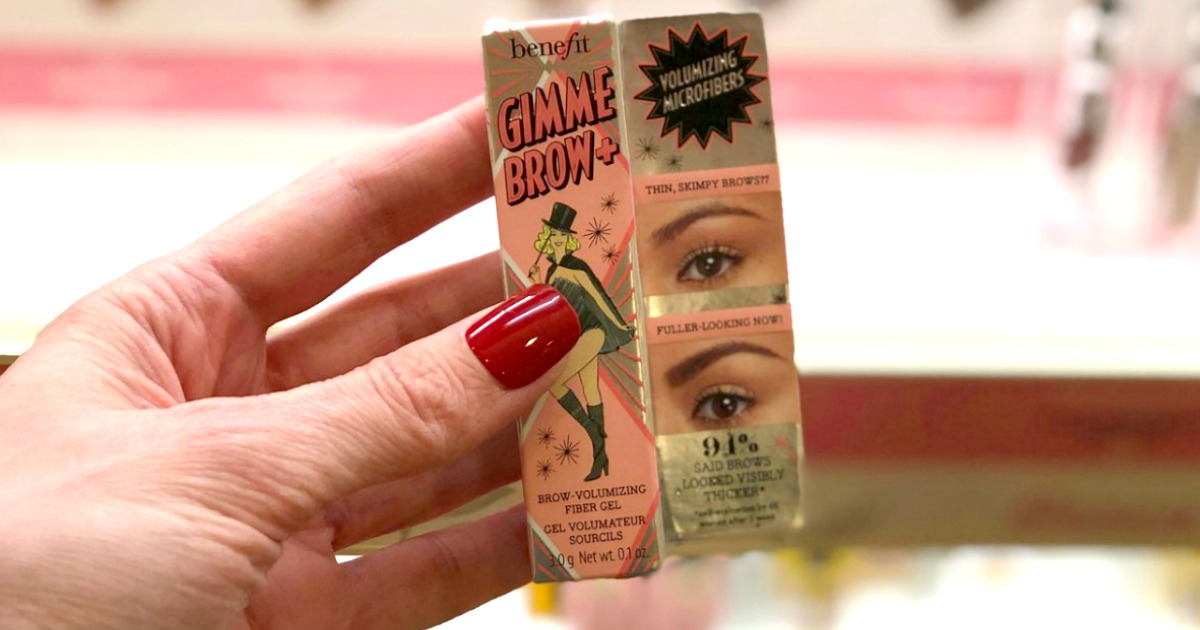 hand holding Benefit Cosmetics gimme brow box
