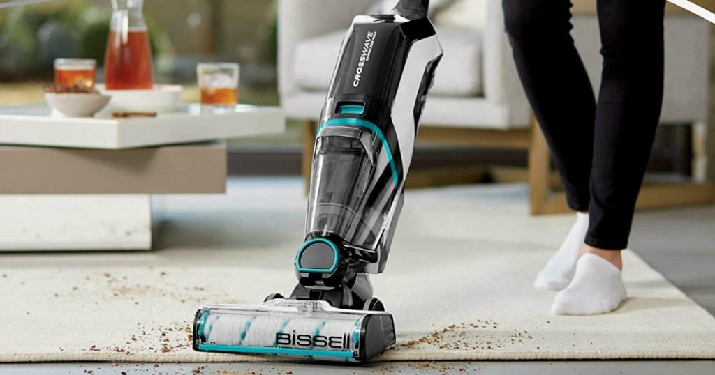 woman pushing a vacuum