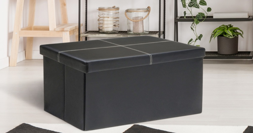 black faux leather storage ottoman in living room