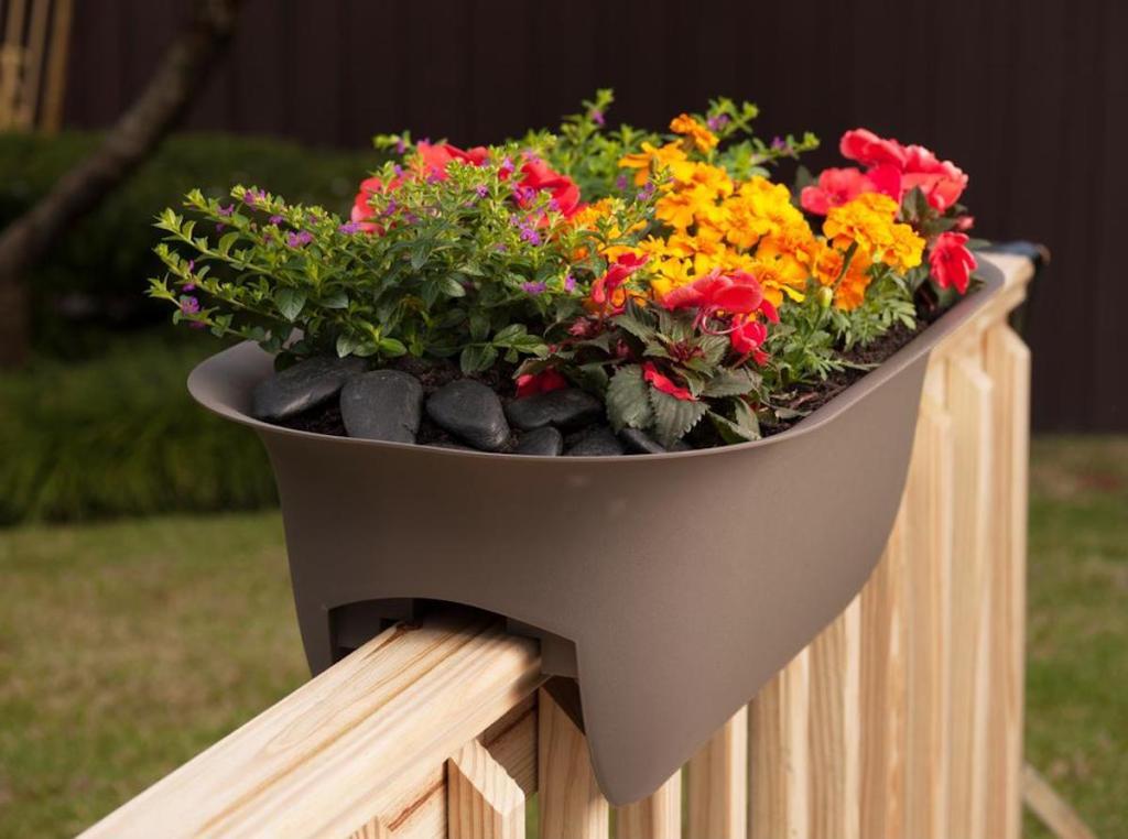Bloem Chocolate Modica Plastic Deck Rail Planter with flowers inside of it sitting on chair railing