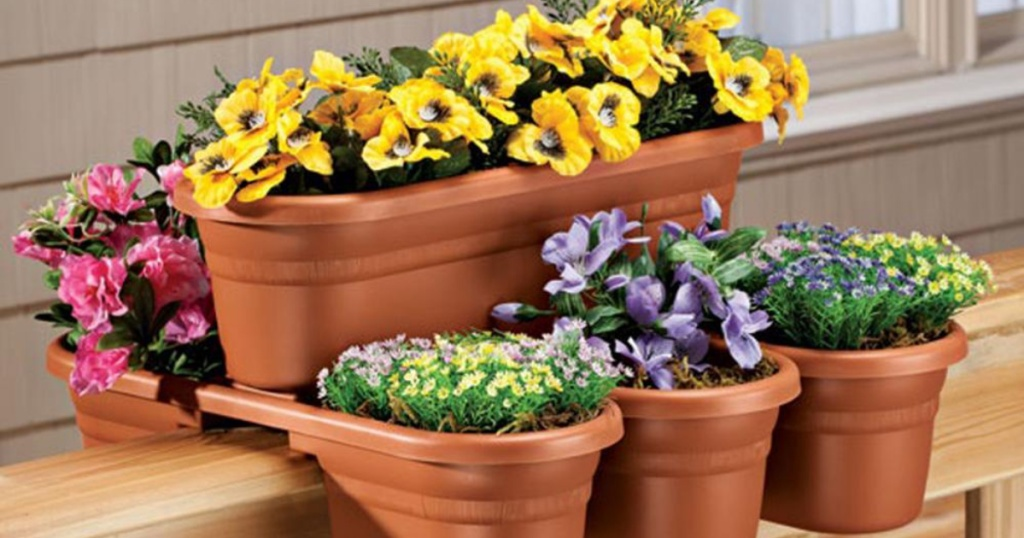 Bloem Terra Cotta Milano Plastic Deck Rail Planter 4-Pack with colorful flowers within the flower pots