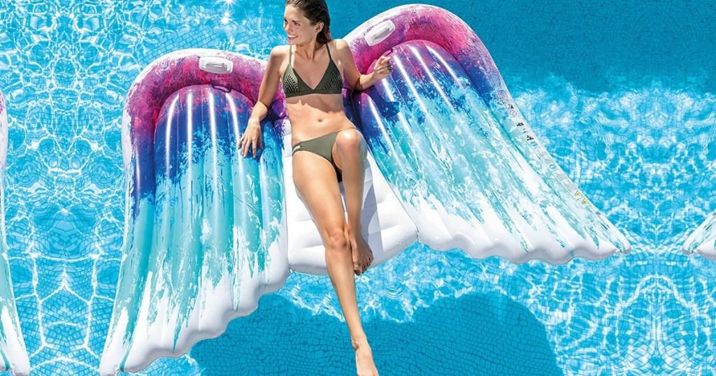 Woman lying on Blue & Fushcia Ombré Wings Pool Float