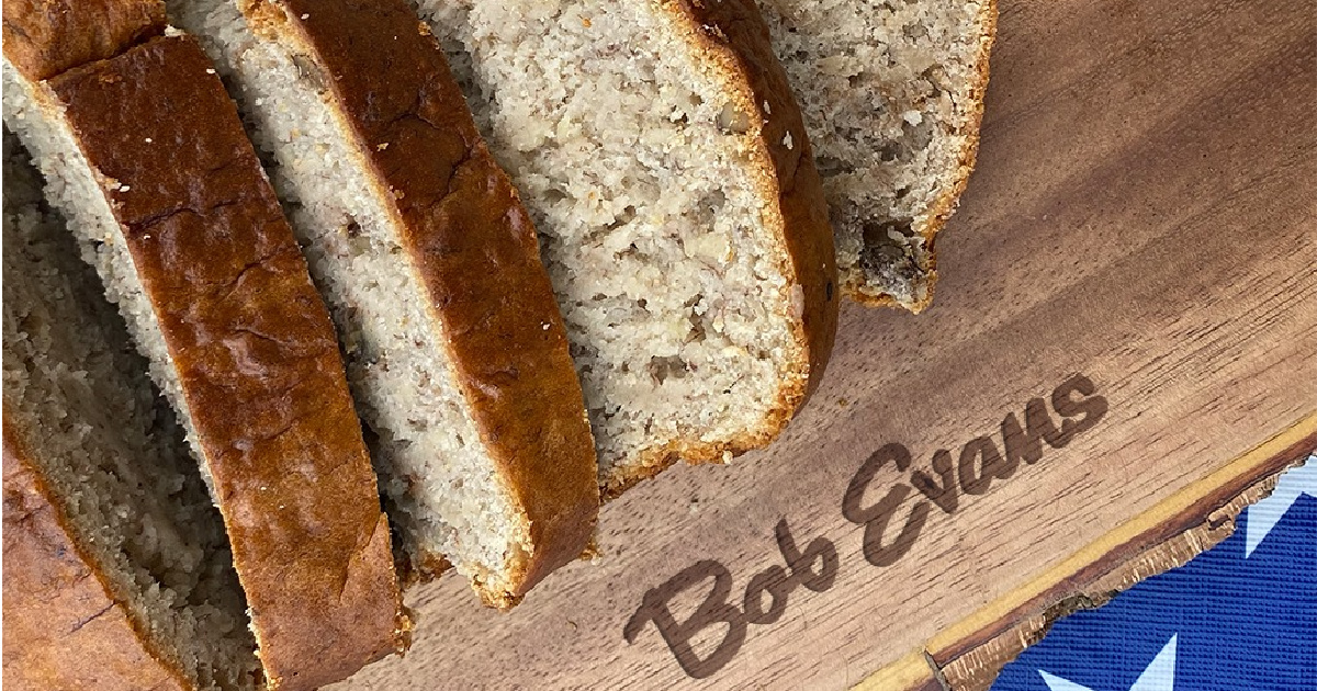 sliced banana nut bread on a cutting board marked with bob evans