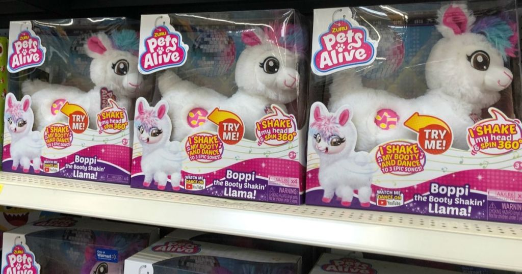 store shelf with boxes of dancing llama toys
