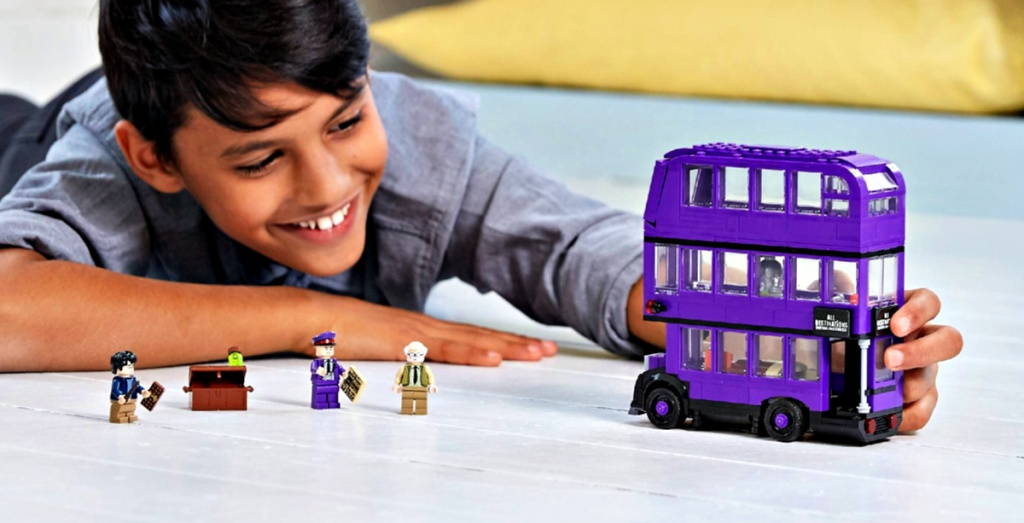 Boy playing with LEGO Harry Potter The Knight Tripple Decker Bus 403-Piece Building Kit