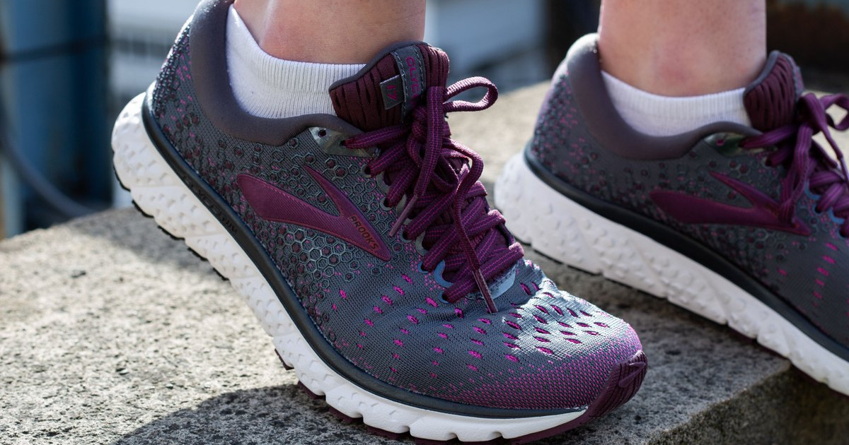 woman in grey and purple running shoe