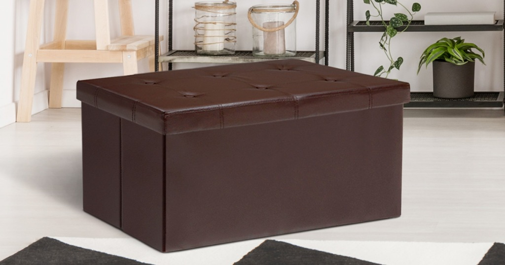 brown faux leather storage ottoman with six buttons on top lid