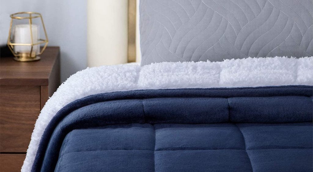 navy blanket on a bed