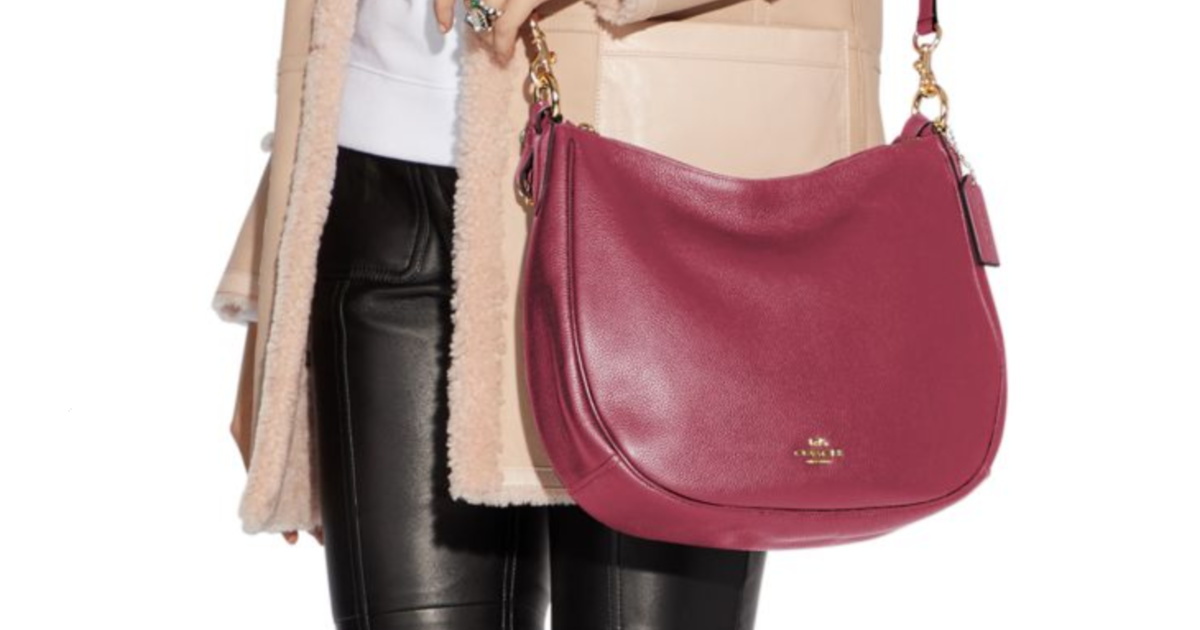 woman with red/pink hand bag
