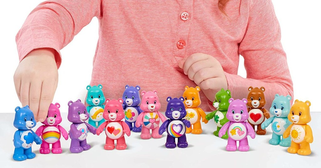 girl playing with Care Bears
