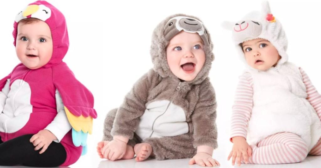 three babies wearing costumes