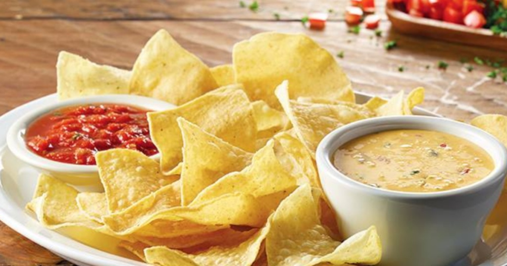 plate with chips, queso, and salsa from cheddars