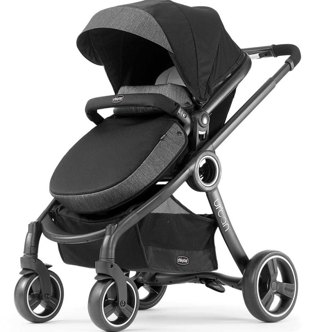 dark grey and black stroller with large wheels and adjustable canopy