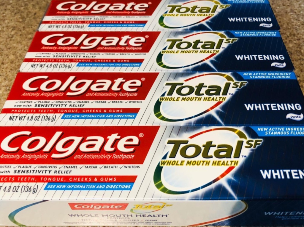 four boxes of toothpaste on counter