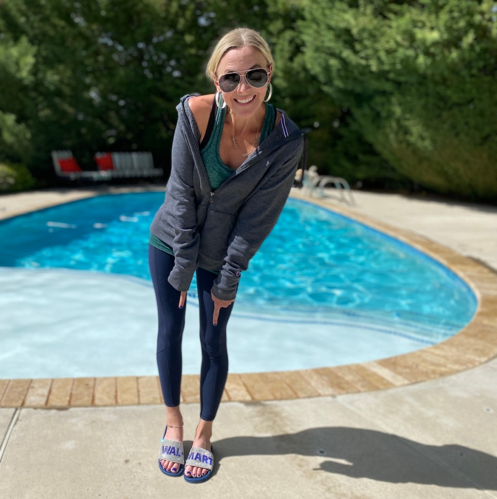 woman wearing sandals that say Walmart