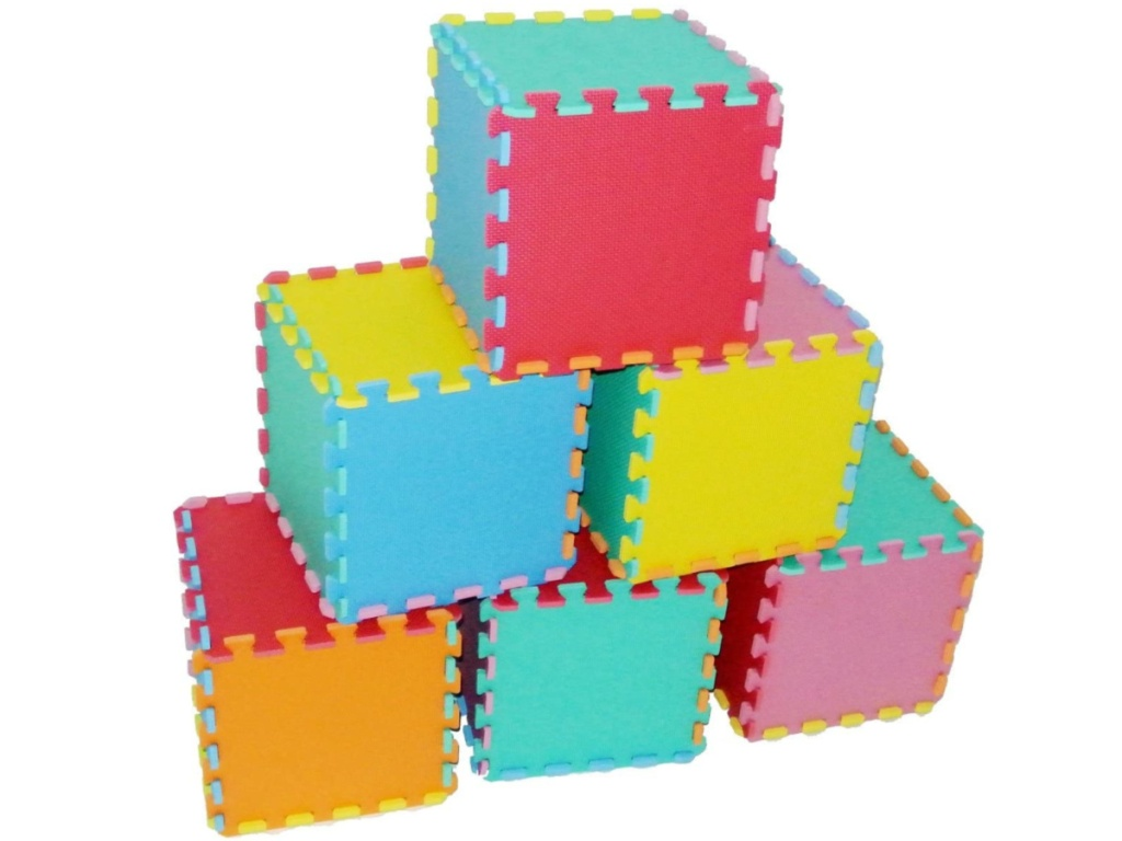 colorful foam tiles made into cube shapes and stacked