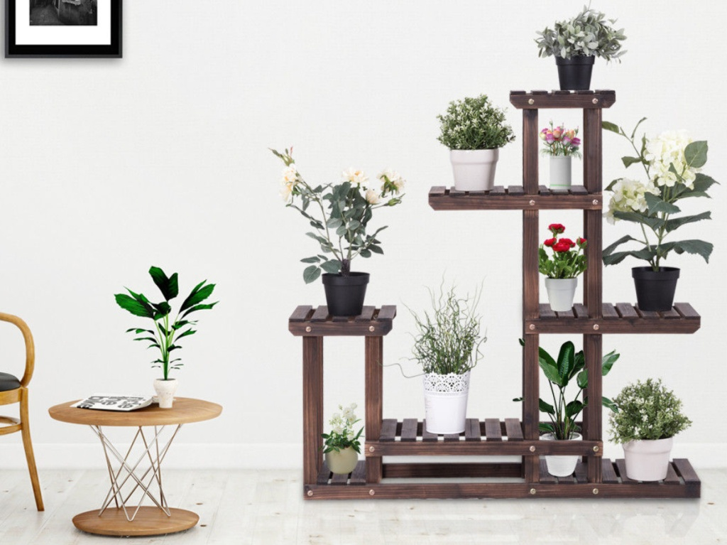 large wooden plant stand inside home next to chair and side table