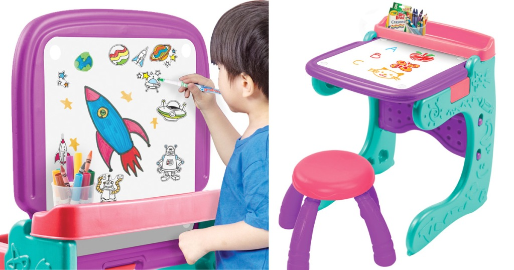 child coloring a spaceship on a whiteboard easel