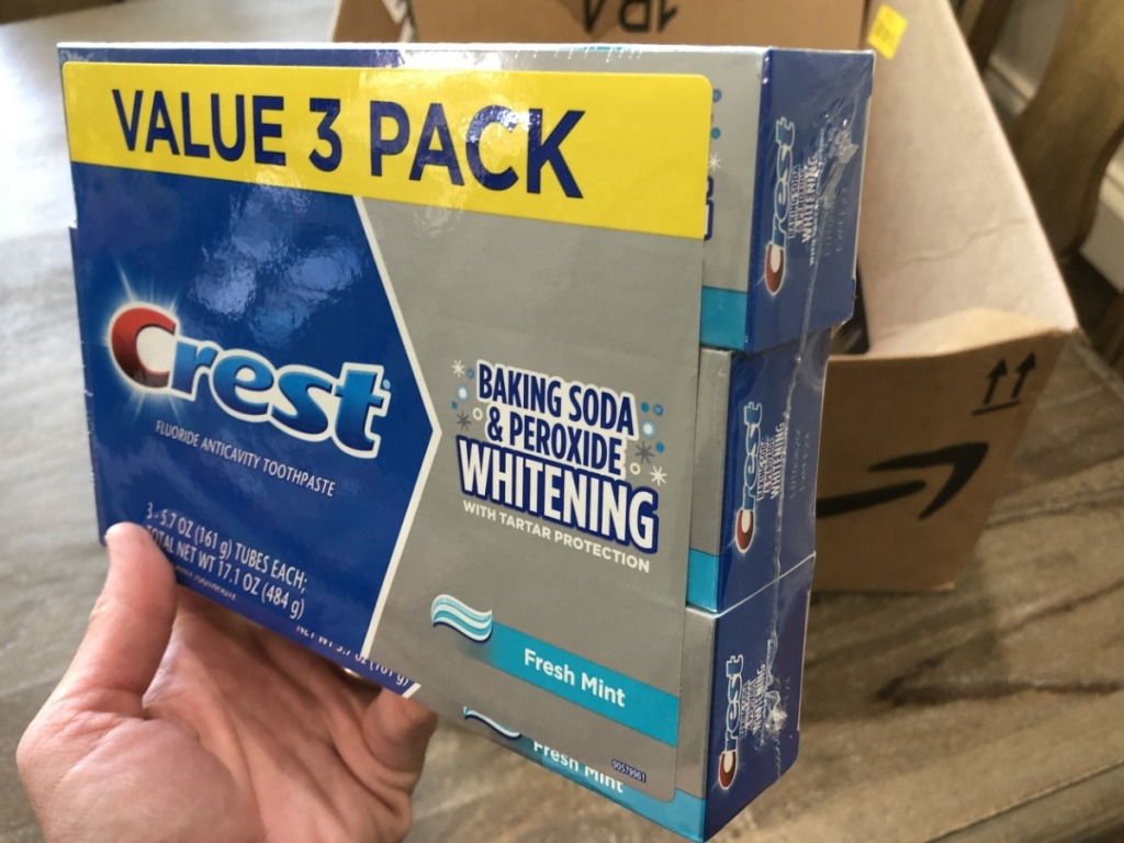 Person holding Crest Fresh Mint Value Pack Toothpaste