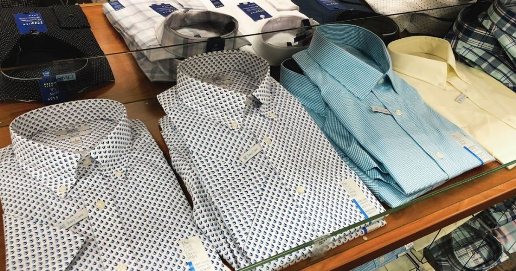 men's folded dress shirts at store on a display