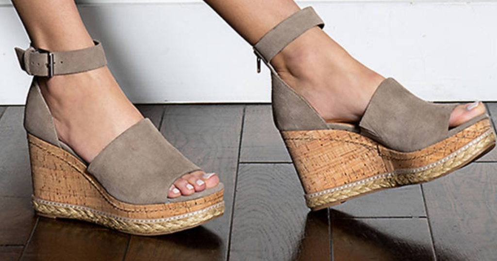 woman wearing wedge shoes
