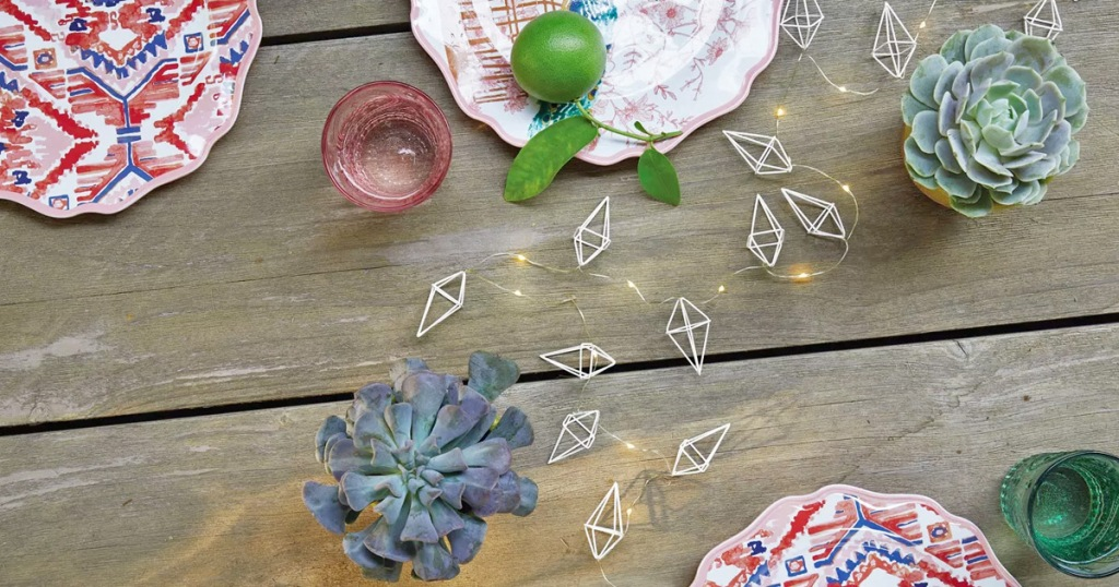 diamond shaped string lights on a wooden table with succulents