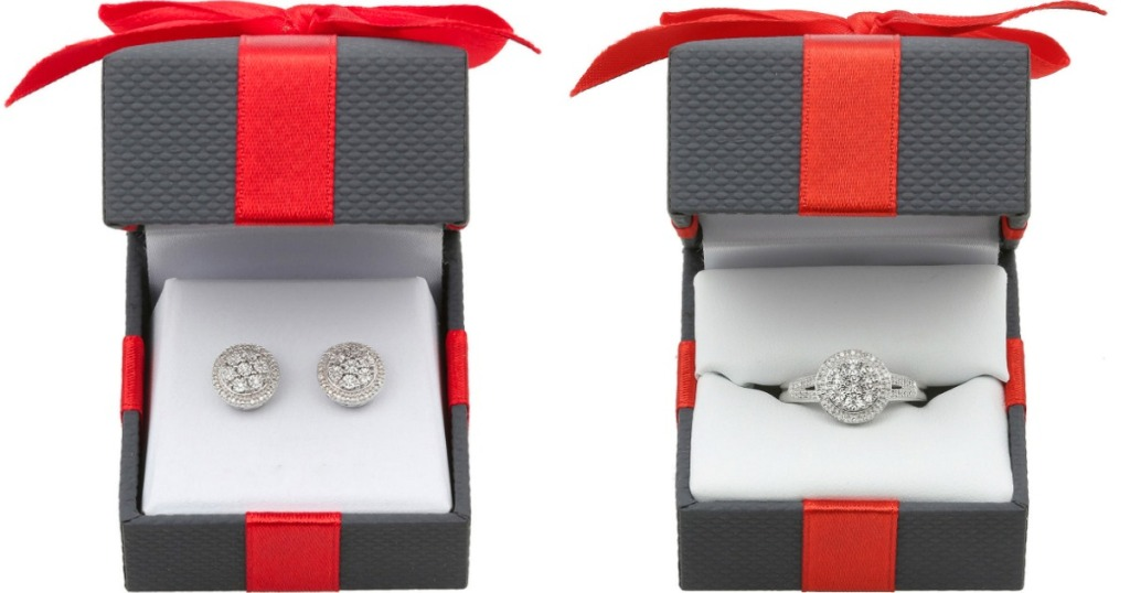 two jewelry boxes with Diamond earrings and ring