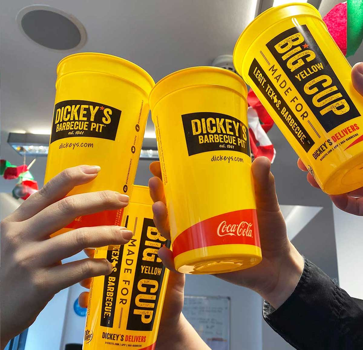 four dickey's barbecue pit cups being toasted in store