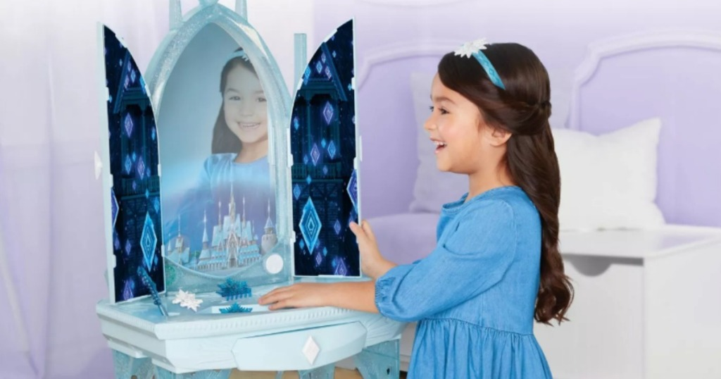 girl playing with Frozen 2 vanity