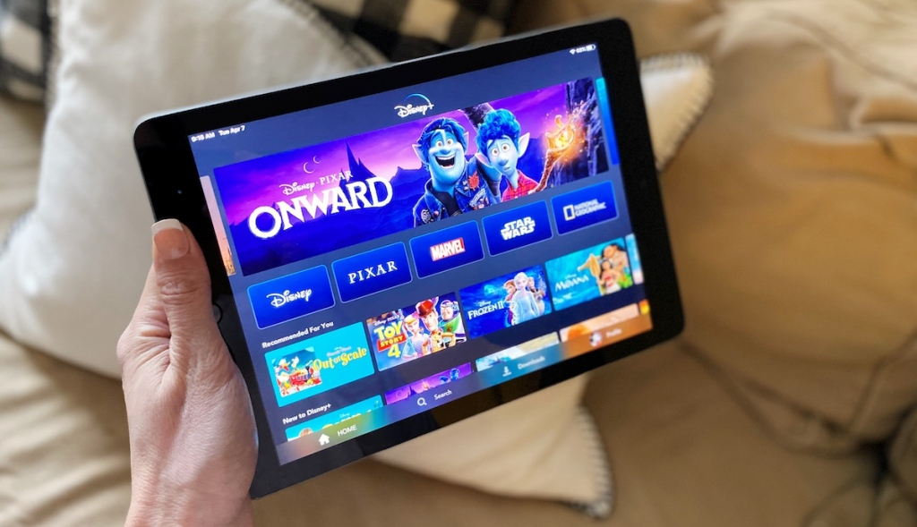 hand holding tablet with Disney movies