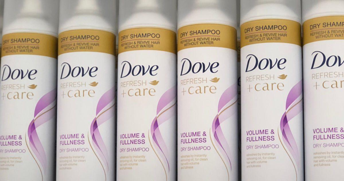 shelf with dove refresh care dry shampoo