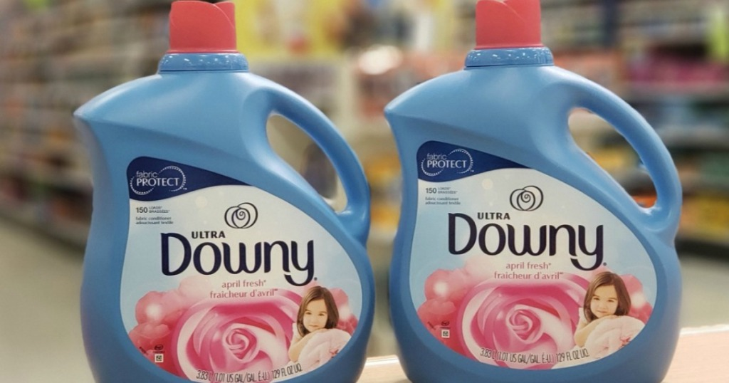two bottles of Downy Ultra on counter at a store