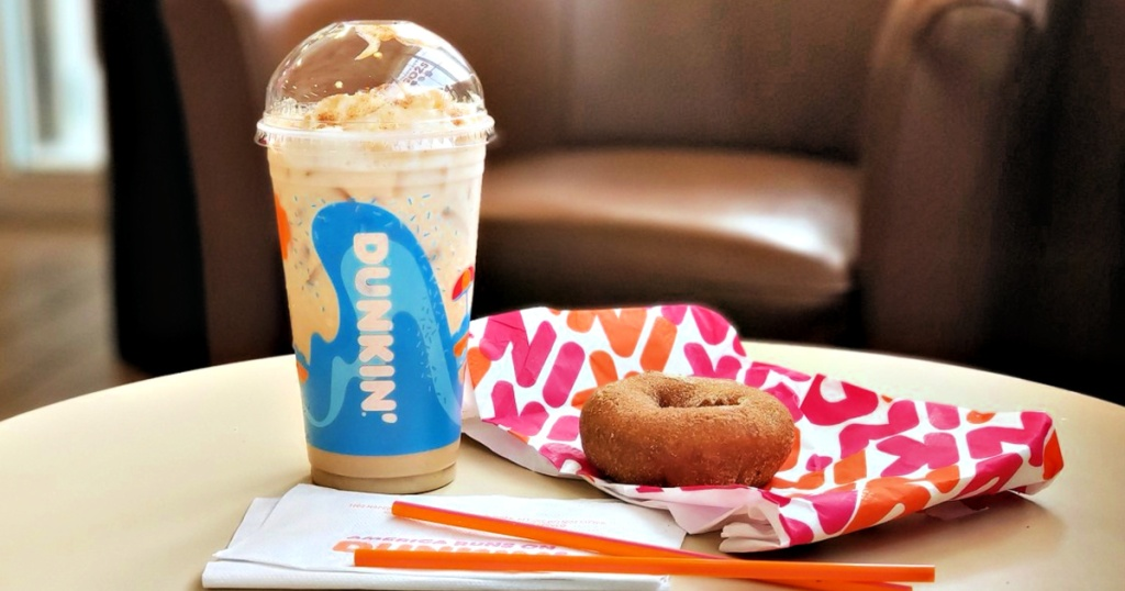 Dunkin donuts drink and donut on table
