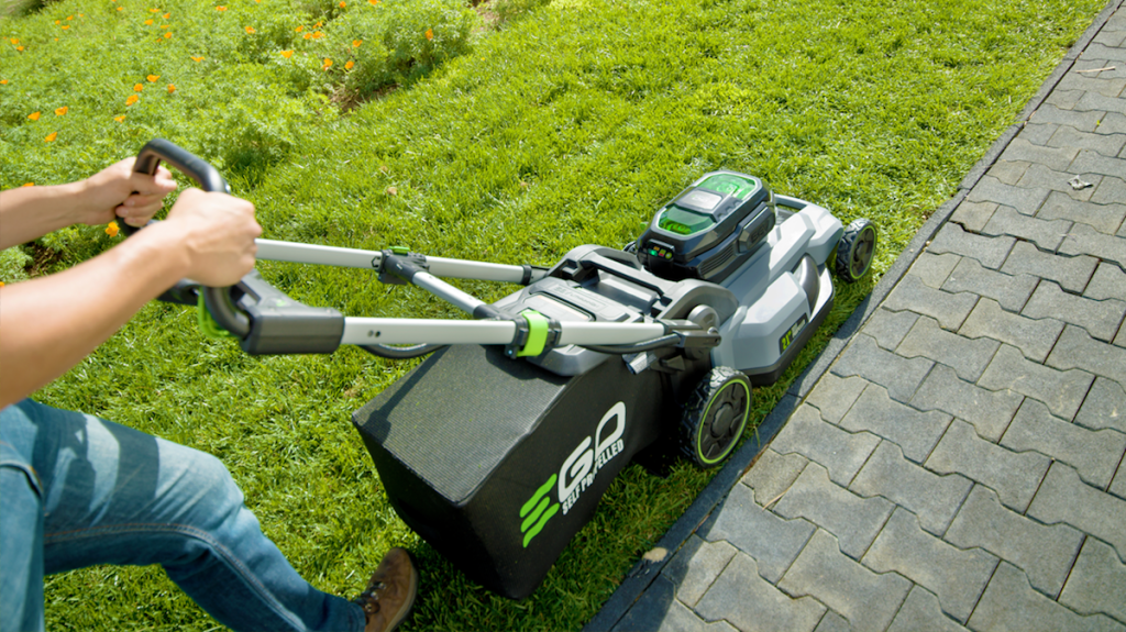person pushing a lawn mower