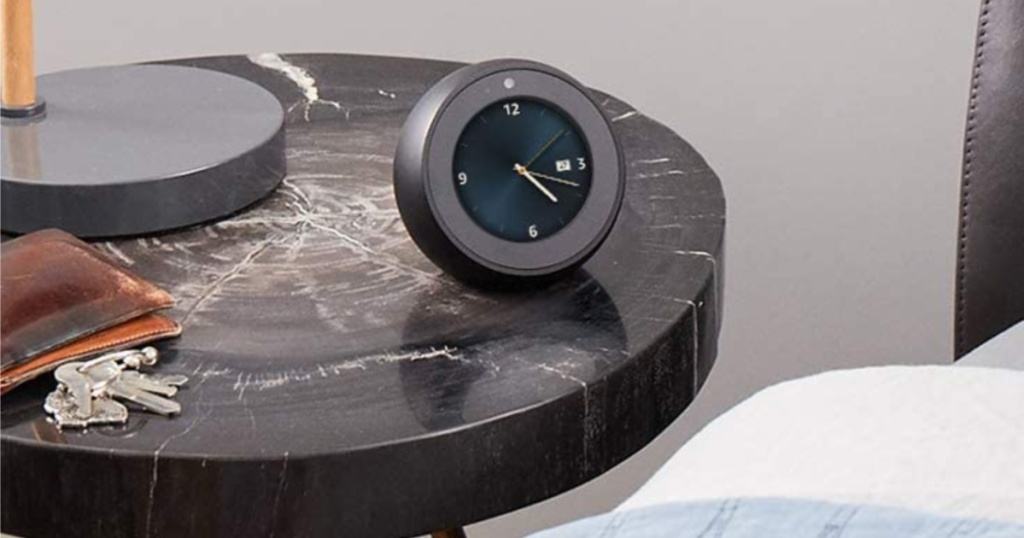 smart alarm clock on bedside table