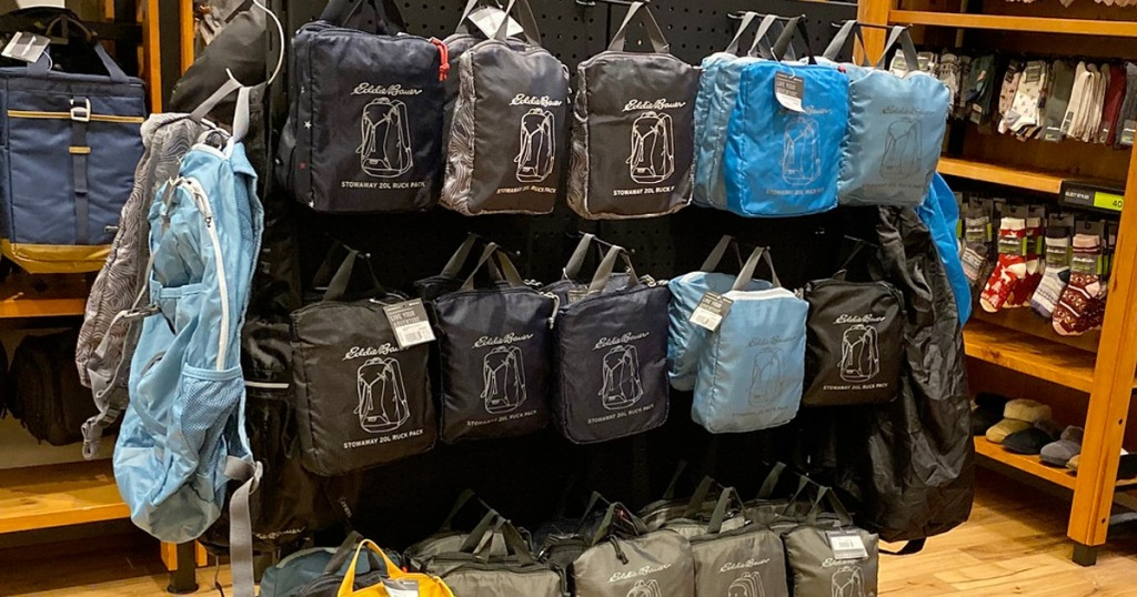 store display of multiple eddie bauer package backpack bags