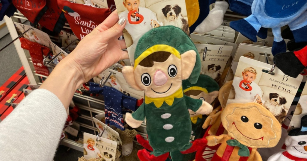 hand holding plush elf holiday dog toy in store