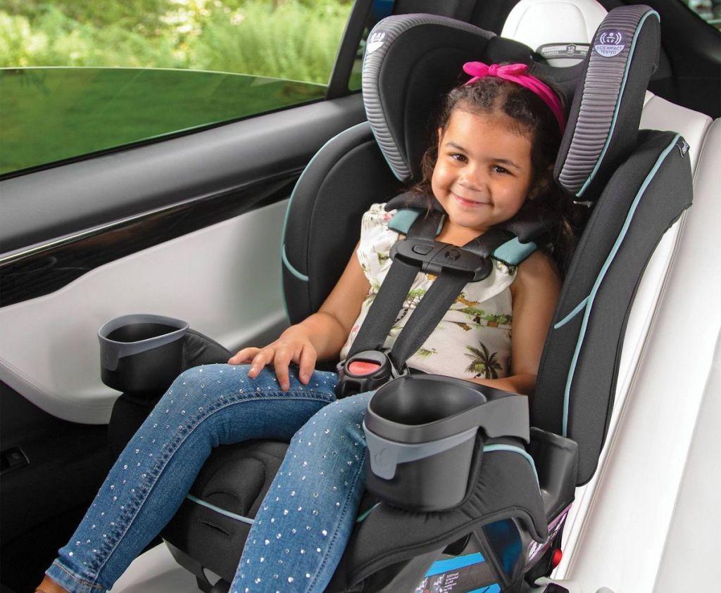 toddler girl in a car seat
