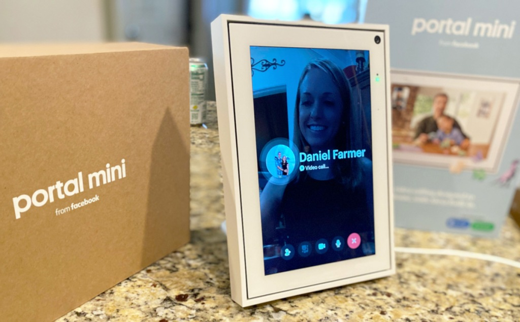 white facebook portal sitting on kitchen counter making a video call